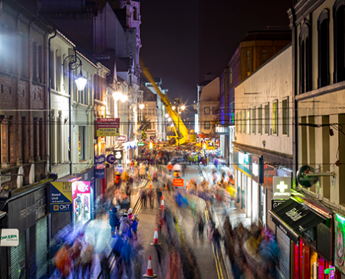 night time lively street scene in derry on destination derry